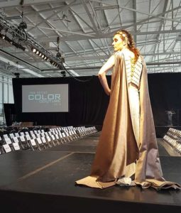 Hoefer Wysocki Interior Designer Bailey Loyd struts the runway in a Roman architecture-inspired gown.